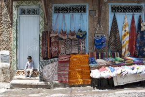 Little boy minding the blanket shop, Chefchaouen